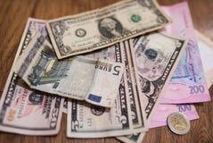 Долларовые банкноты, предпосылка денег Денег доллары конца комплекта вверх Стоковые Фотографии RF