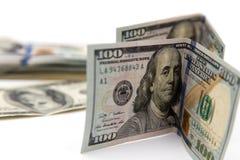 100 долларовых банкнот на белой предпосылке Стоковая Фотография RF