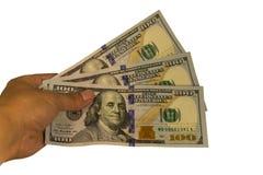300 долларов в руке изолированной на белой предпосылке Стоковое Фото