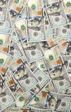 100 долларов складывают как предпосылка, предпосылка от долларов Стоковые Фото