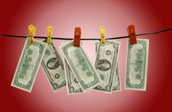 Доллары висят на веревочке Стоковая Фотография RF