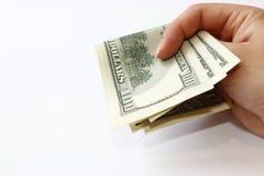 Доллары в руке Стоковое Изображение RF