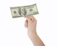 Доллары дег удерживания руки Стоковые Изображения