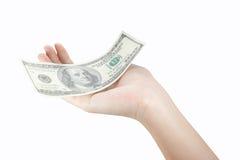 Доллары дег удерживания руки Стоковые Фото