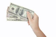Доллары дег удерживания руки Стоковые Фотографии RF