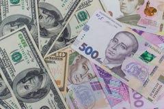 доллары и новое украинское hryvnia Стоковые Фотографии RF
