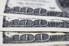 Доллары концепции крупного плана Американские доллары денег наличных денег доллар 100 одно кредиток Стоковое фото RF