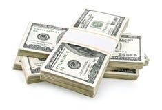 доллары кучи упакованной деньгами Стоковые Изображения
