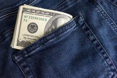 Доллары счета в заднем карманн джинсов Стоковое Фото