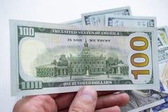 Доллары, фото крупного плана 100 банкнот доллара на белизне Стоковые Фотографии RF