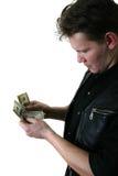 доллары человека s руки Стоковое Изображение