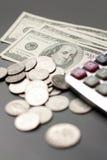 доллар монетки чалькулятора Стоковая Фотография