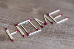 Домашний знак написанный с спичками Стоковое Изображение