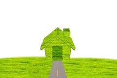 Домашний значок от предпосылки травы, изолированной на белизне Стоковые Фото