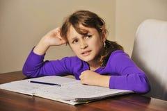 домашняя работа девушки Стоковое Фото