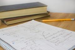 Домашняя работа математики с карандашем и книгами Стоковое Изображение RF