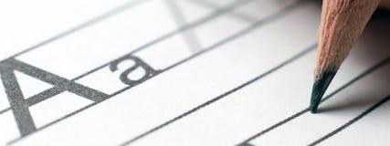 Домашняя работа учить принципиальной схемы учить алфавита почерк s Стоковое фото RF