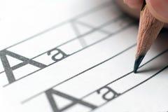 Домашняя работа учить принципиальной схемы учить алфавита Стоковые Фото