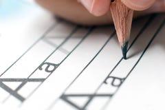Домашняя работа учить принципиальной схемы учить алфавита Стоковая Фотография