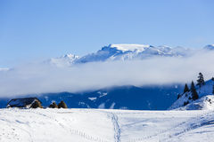 Дома в горах в зиме Стоковое Изображение