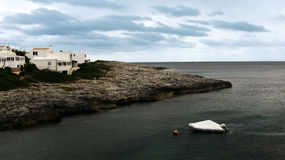 Дома в малом заливе в Менорке сфокусируйте мягко Стоковое Изображение RF