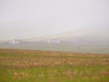 Дома в тумане Стоковое Изображение