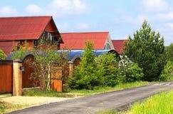 Дома за загородкой Стоковые Изображения