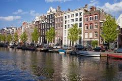 Дома канала Singel в Амстердаме Стоковая Фотография