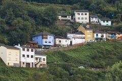 Дома на холме леса в Cangas del Narcea astrological стоковые фотографии rf