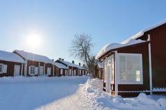 Дома Falun красные в городке церков Gammelstad Стоковая Фотография