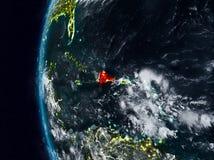 Доминиканская Республика от космоса во время ночи Иллюстрация штока