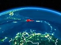 Доминиканская Республика от космоса на ноче Стоковое Фото