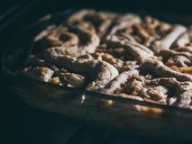 Домодельное cinnabon в форме Принципиальная схема праздника Стоковая Фотография RF
