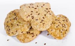 Домодельные печенья с семенем льна на белой предпосылке Стоковые Фото