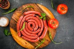 Домодельные сырцовые сосиски говядины Стоковая Фотография