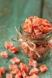 Домодельные candied части сквоша butternut в стеклянных опарнике и scatte Стоковые Фотографии RF
