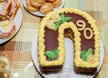 Домодельный именниный пирог для 90 годовщин Стоковое Изображение RF