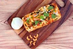 Домодельный хлеб шпината с гайками лука и анакардии Стоковые Фото