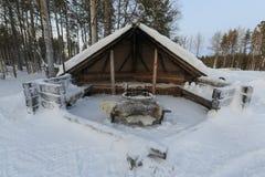 Дом в деревне в зиме Стоковая Фотография