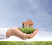 Дом в руке Стоковая Фотография