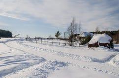 Дом в снежной украинской деревне Стоковая Фотография RF