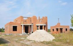 Дом жилищного строительства здания от кирпичей дом конструкции незаконченная Стоковые Изображения