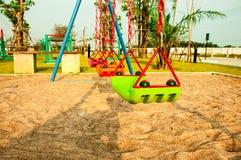 Дом и песок оборудования спортивной площадки цвета стоковое фото