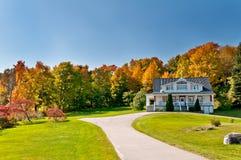 Дом и пуща осени Стоковая Фотография