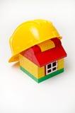Дом и шлем Стоковые Изображения