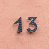 Дом 13 на розовой стене Стоковое Изображение