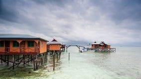 Дом на ходулях стоковое фото rf