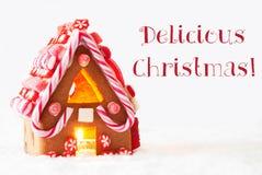 Дом пряника, белая предпосылка, отправляет СМС очень вкусное рождество Стоковые Фото