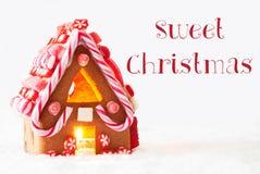 Дом пряника, белая предпосылка, отправляет СМС сладостное рождество Стоковое Изображение