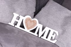 Дом слова в белых письмах как украшение на кресле Стоковая Фотография RF